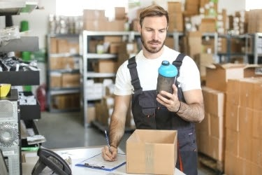 Man doing Quality Assurance of a returned product
