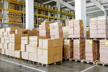 Pile of organized boxes inside a warehouse