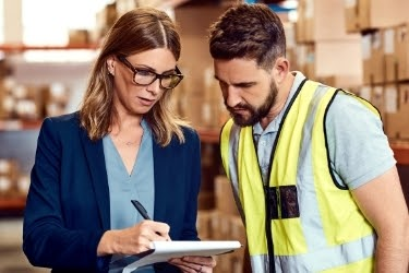 Woman and man discussing inside a warehouse