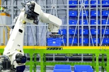 robot arm placing things on conveyor belt