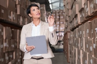 Woman doing manual tracking inventory method