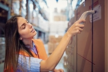 Woman scanning a batch of product