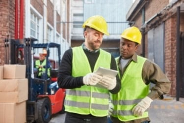 Logistic workers using a tablet