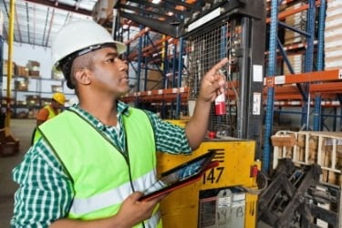 Warehouse worker checking inventory