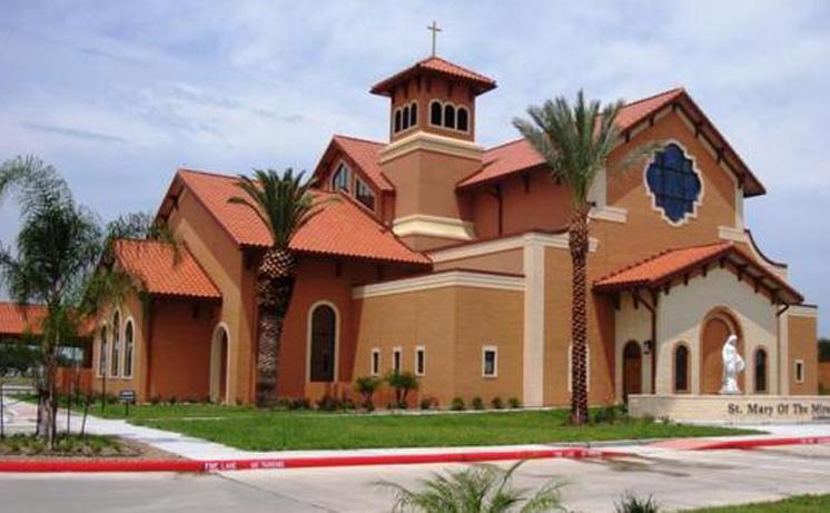 A tan colored church building