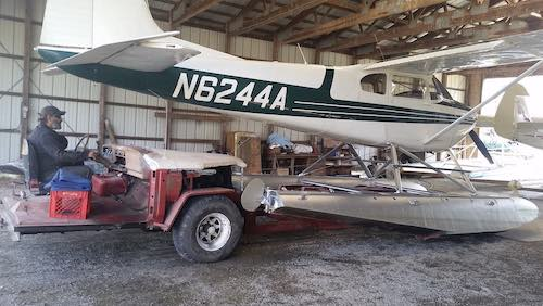 Twitchell's Airport | Mark McGhee moving a floatplane in the hangar with a purpose built small tractor named 'Cyclops'