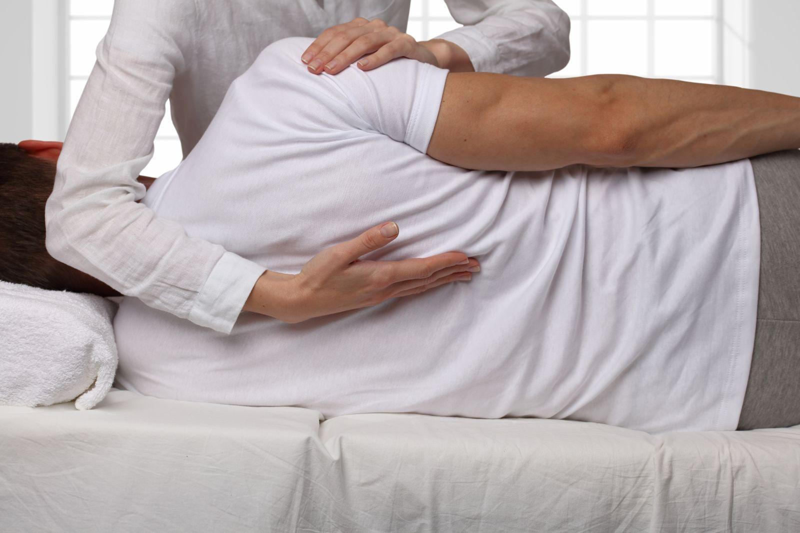 Dr. Beau massaging someone's lower back