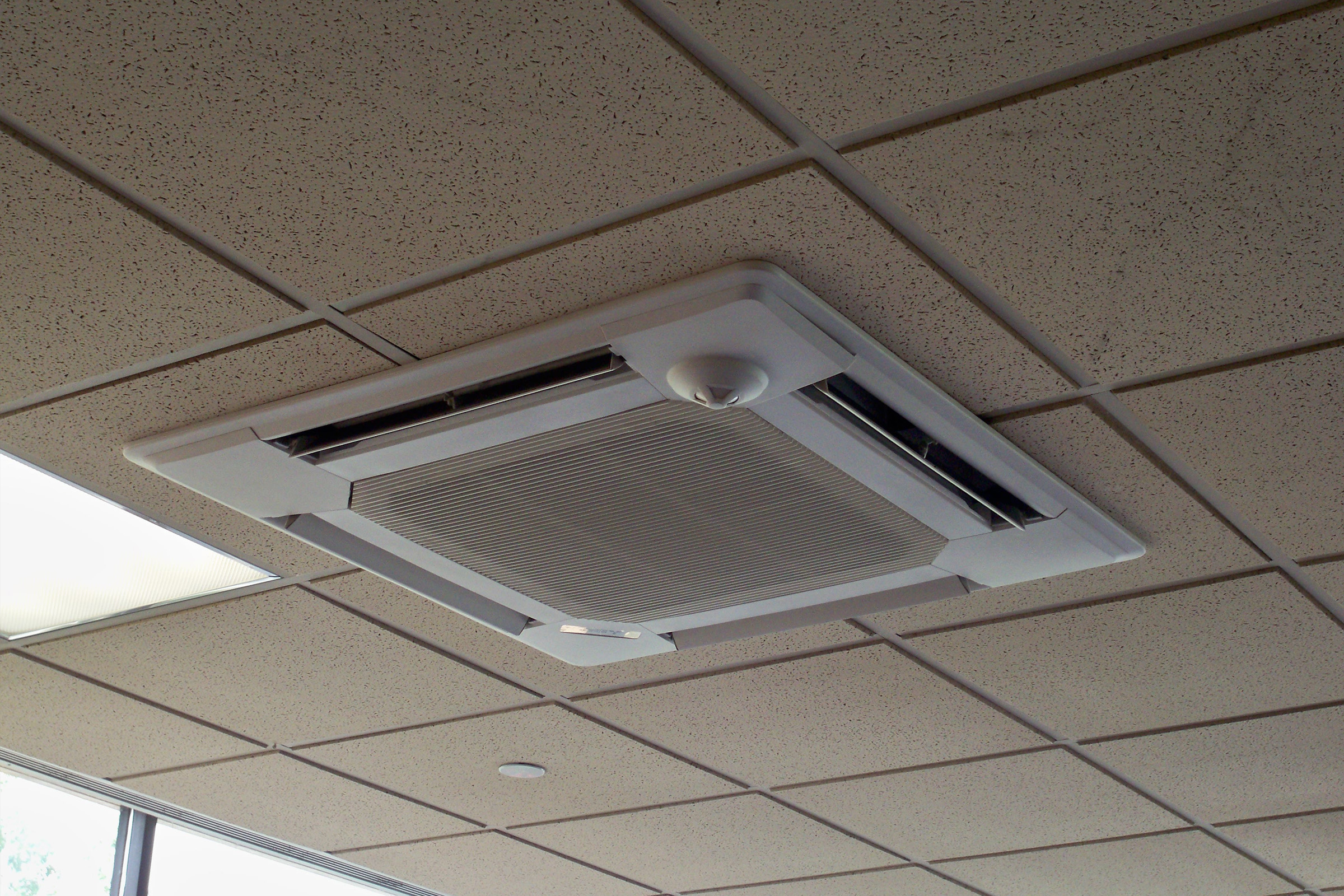 Upgraded HVAC system with ceiling mounted ductless air conditioning and heating units for restaurant dining area