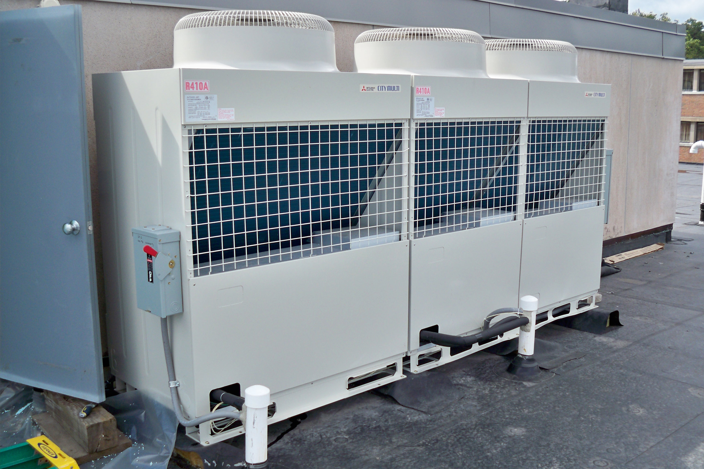 Upgrade rooftop air handler unit for existing commercial building.