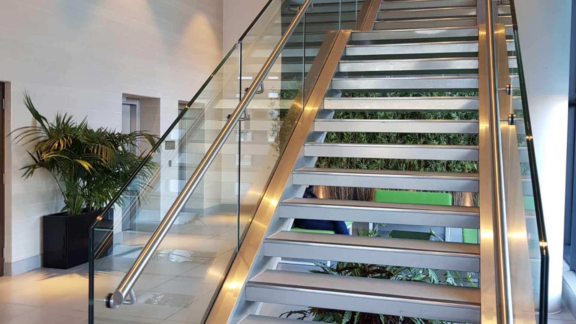 Shiny office staircase in foyer