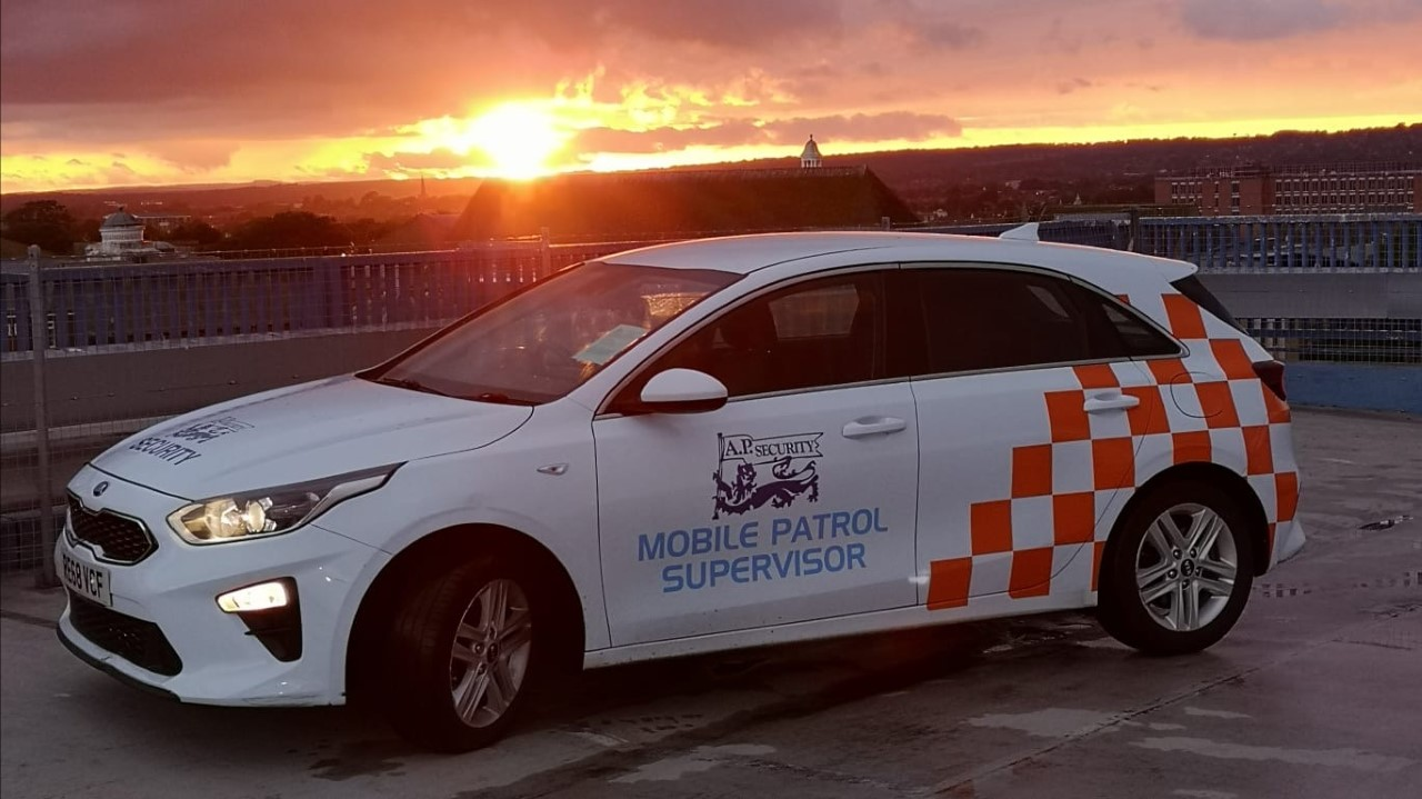 AP Security manned patrol car at sunset