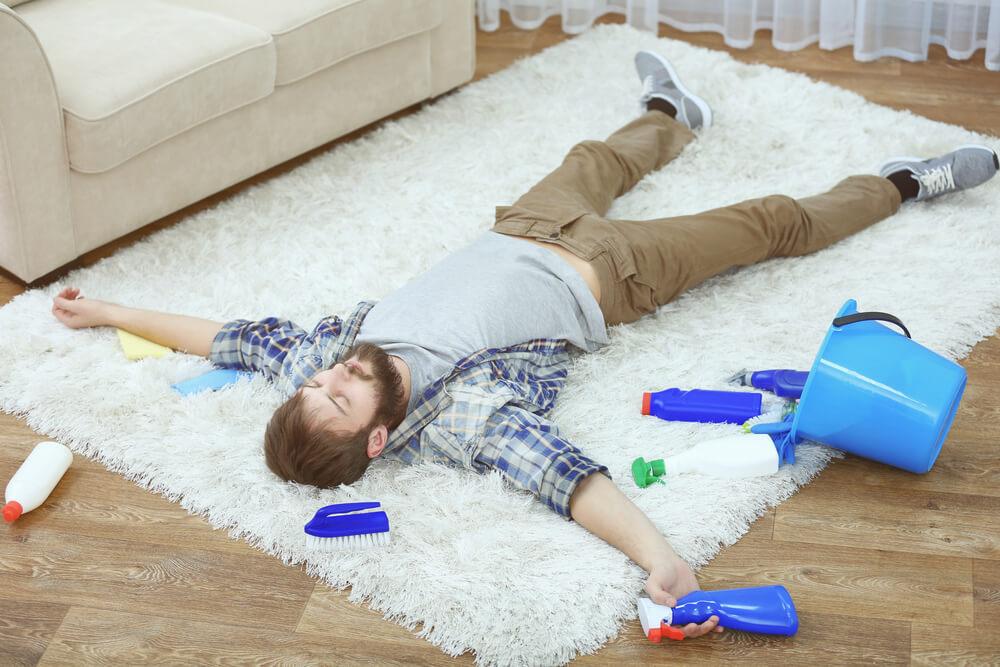 Gentleman laying down on rug
