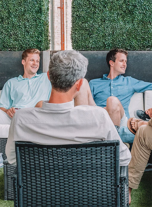 Team photo relaxing in an outdoor lounge