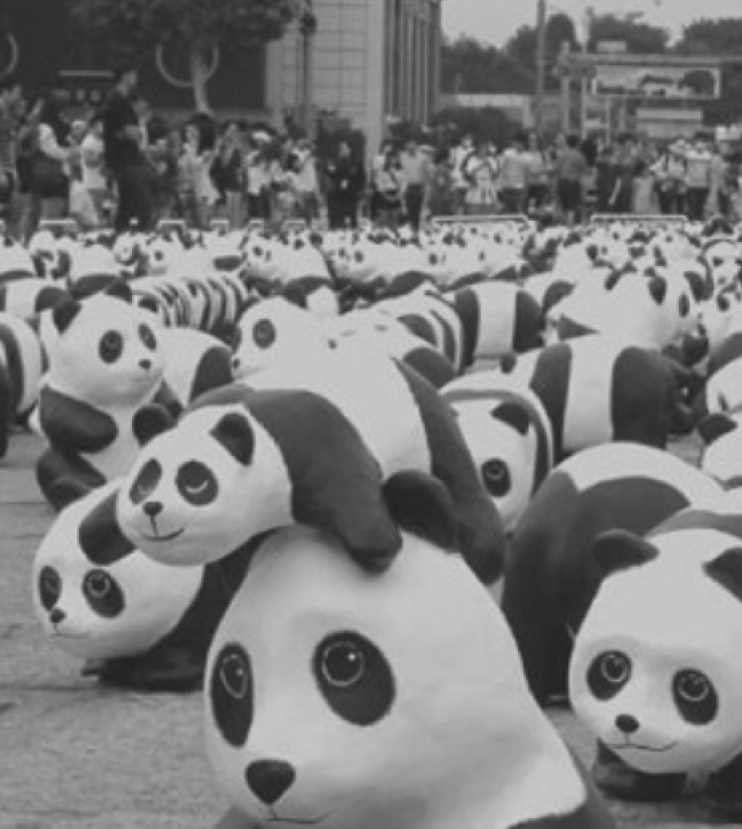 A bunch of random Panda statues scattered around a park area