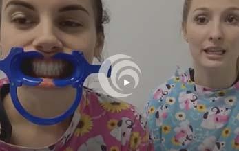 Woman wearing dental cheek retractor