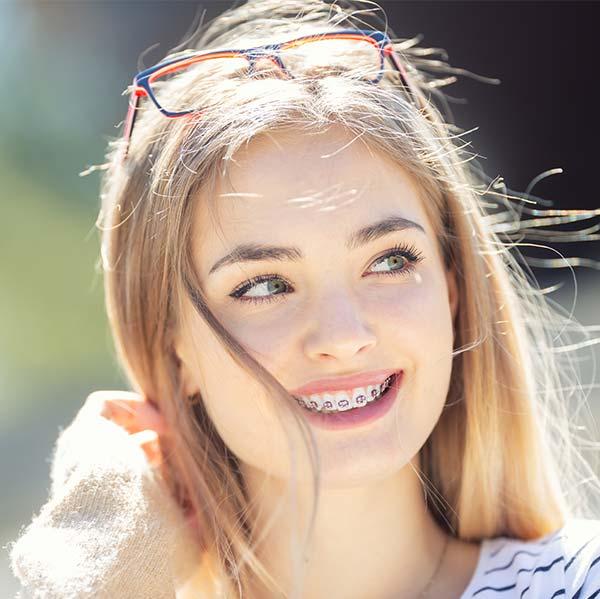 Teenage girl with braces smiling