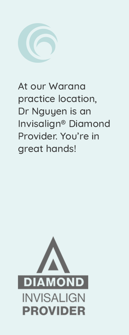 Smiling woman with Invisalign aligner
