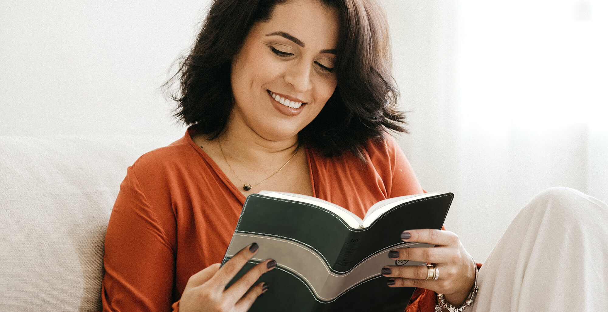 Woman reading The Family Wins