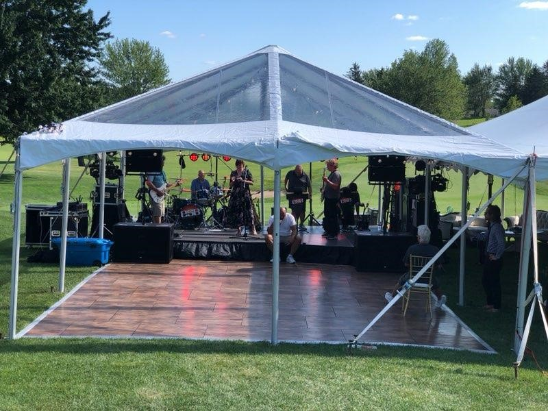 outdoor wedding tent with band