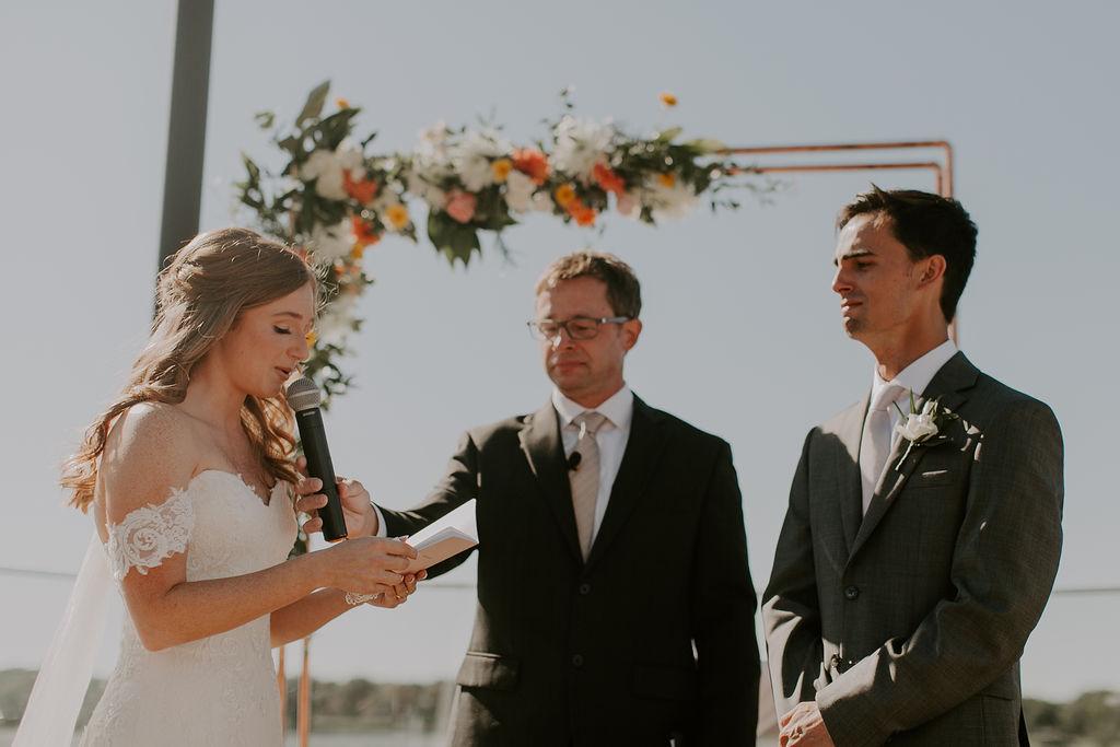 bride saying wedding vows