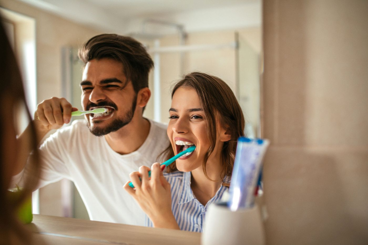 Couple taking care of teeth by brushing after treatment