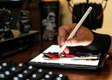 A black illustrator designing and drawing an illustration on tablet