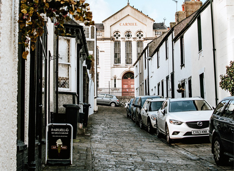 A street is busy with parked cars