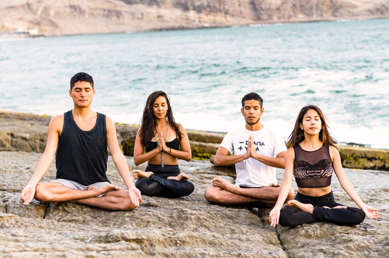 fitness, sport, yoga and healthy lifestyle concept - group of