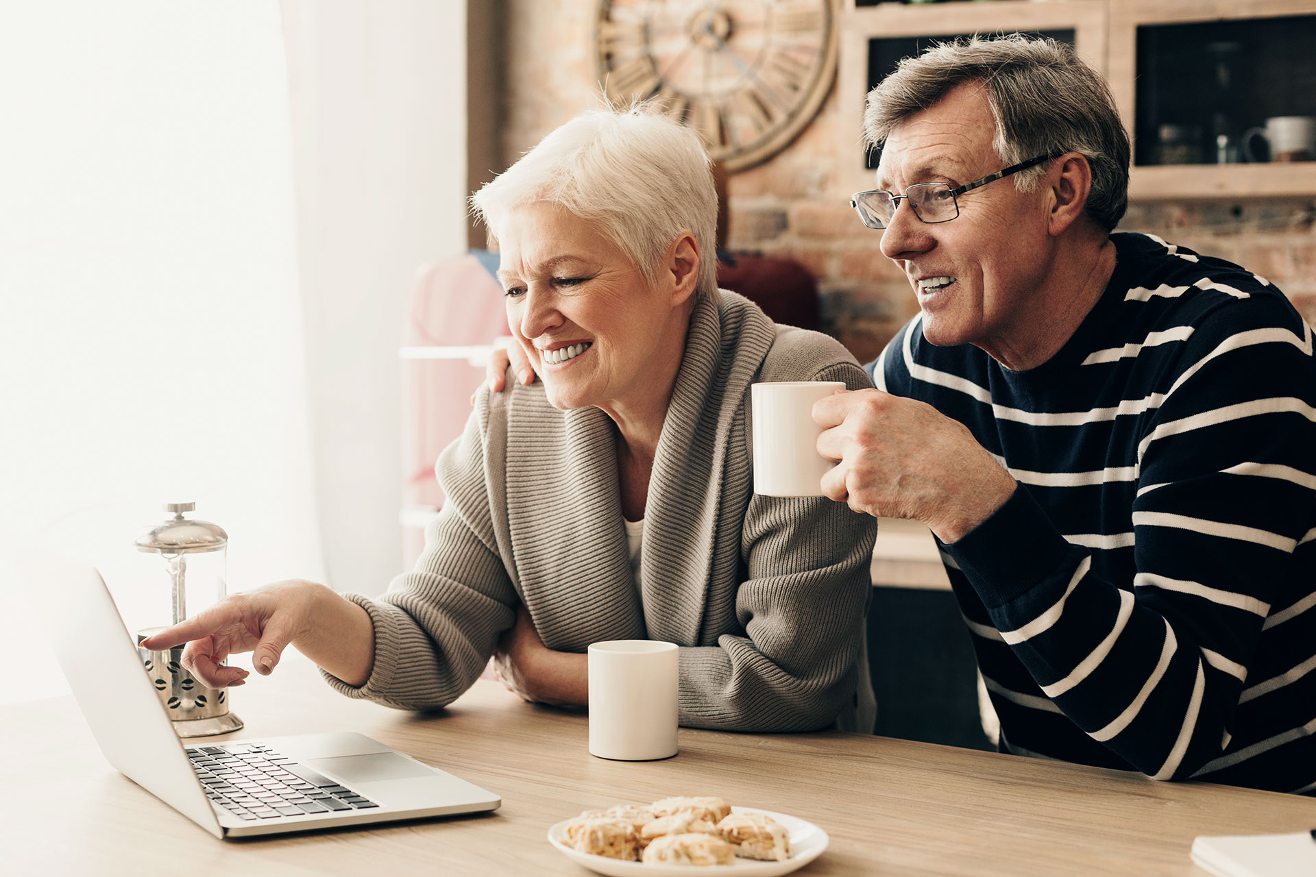 Retired couple checking their finances online.