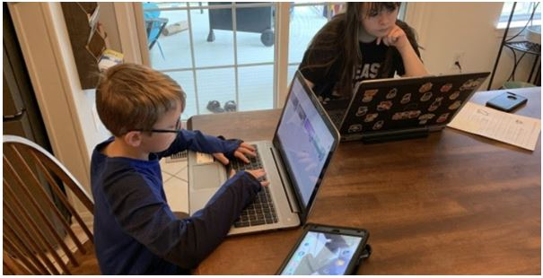 children studying with laptop