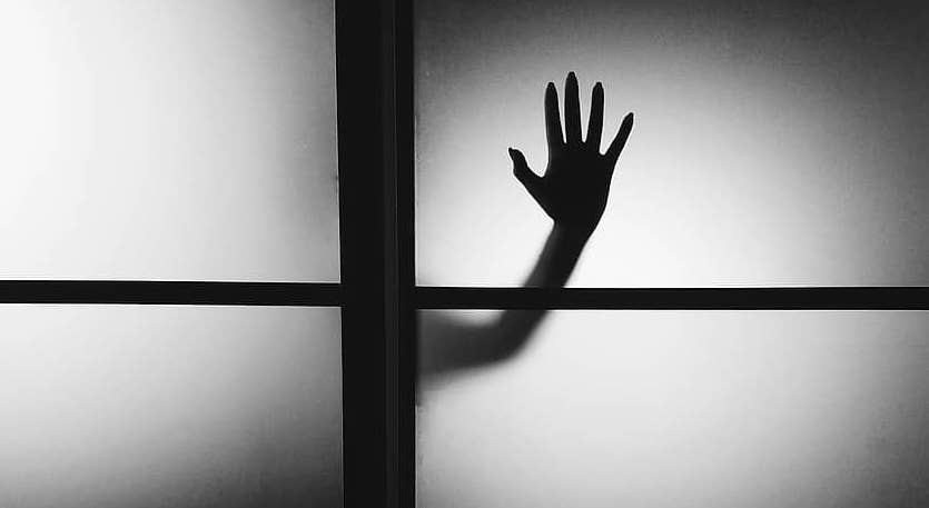 Hand on the window