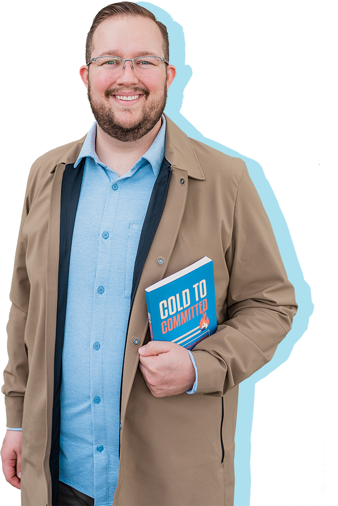 An image of Kyle Vamvouris holding his book Cold to Committed.