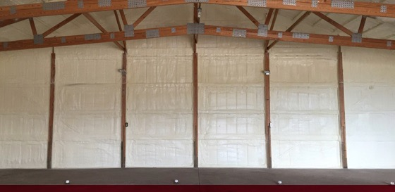 spray foam insulation applied to walls of pole barn