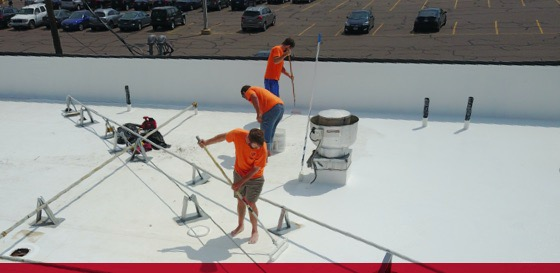titan team installing roof coating