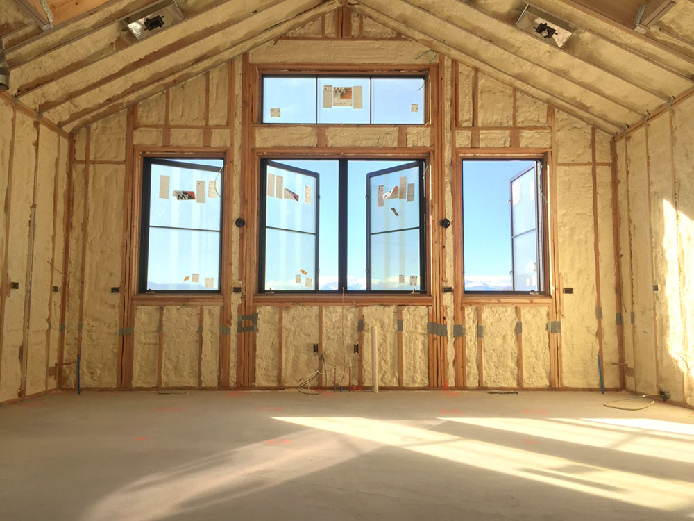 Spray foam insulation in custom home.