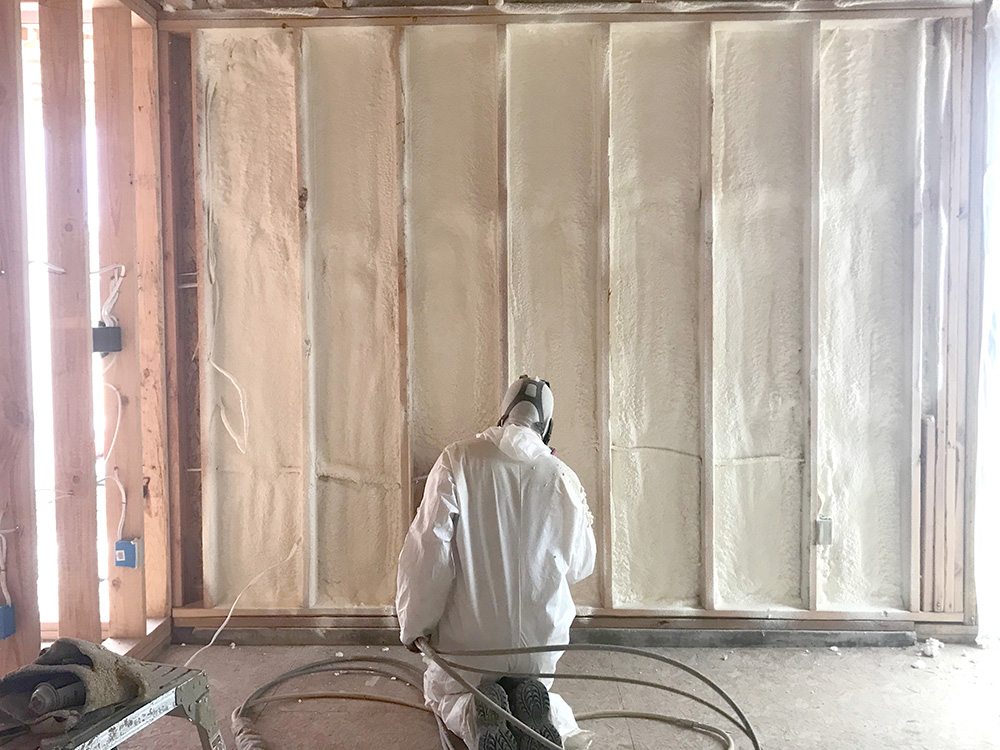 Titan applicator installing spray foam in Loveland, CO home