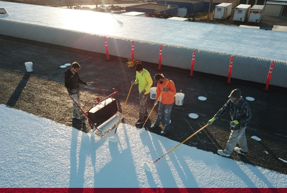 titan team installing new silicone roof coating