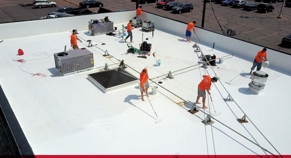 titan team installing new coating on restaurant rooftop