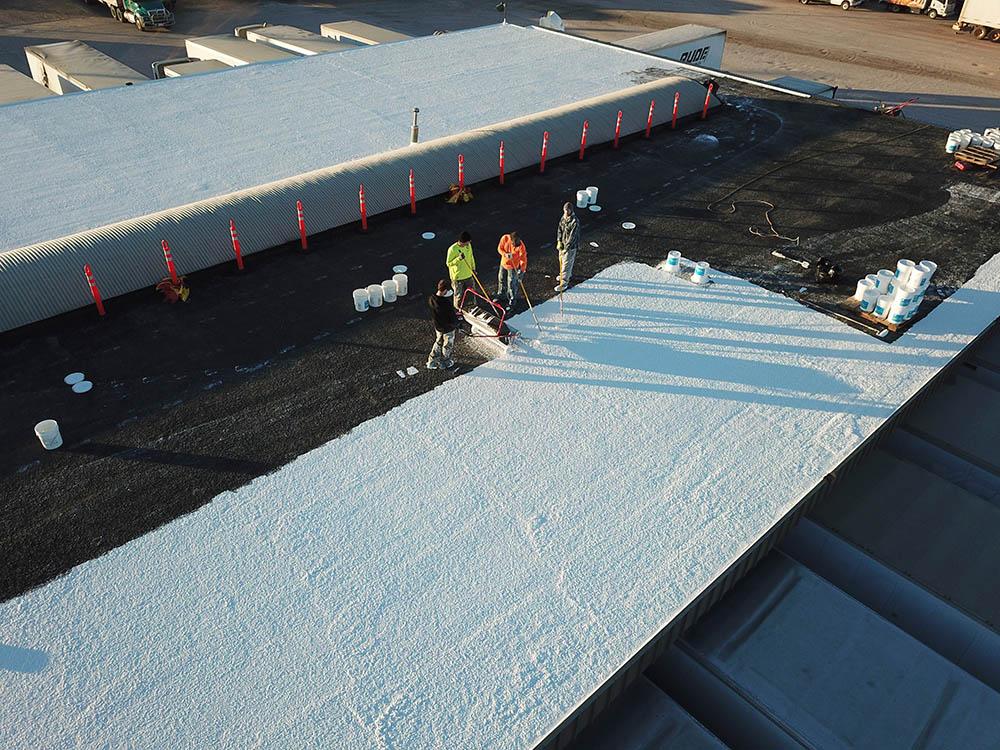 Denver, CO trucking center roof during spray foam work.