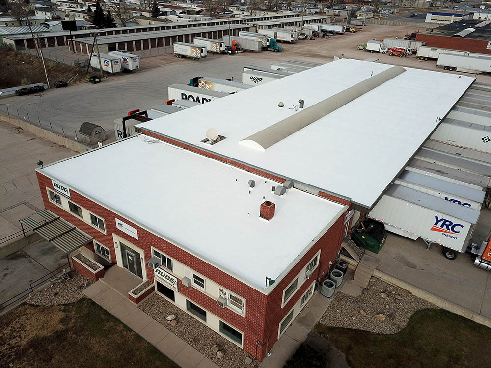 Denver, CO trucking center completed spray foam roof.