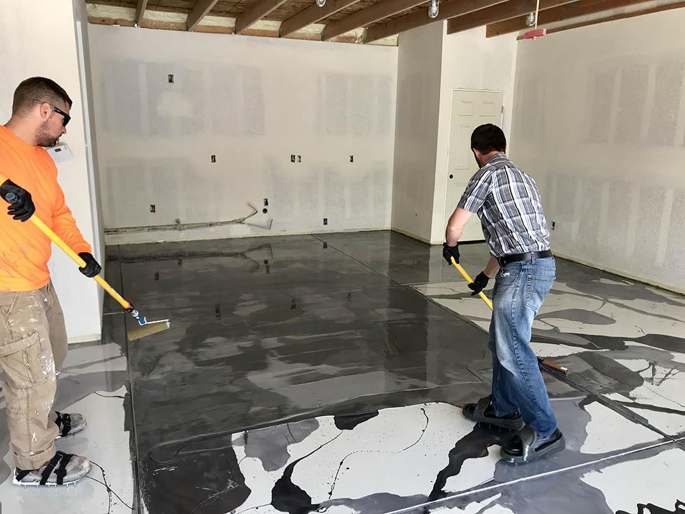 Metallic epoxy garage floor coating installation process.