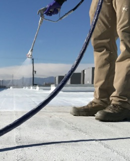 spray foam installer on roof