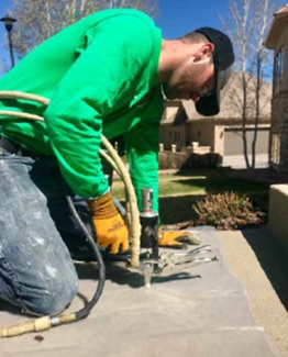 installer performing concrete repair work