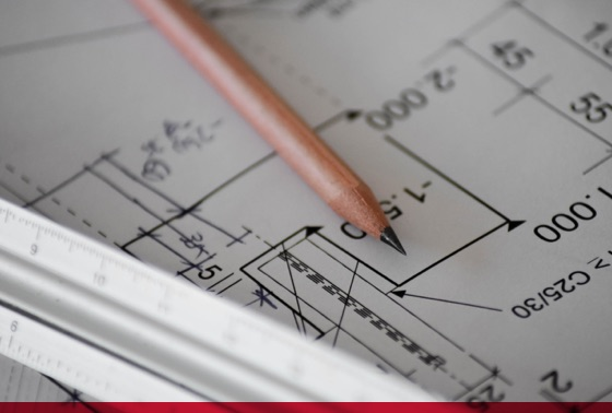 pen and ruler on blueprint