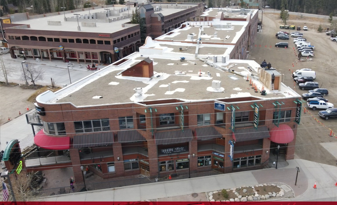 titan applicator employee coating roof