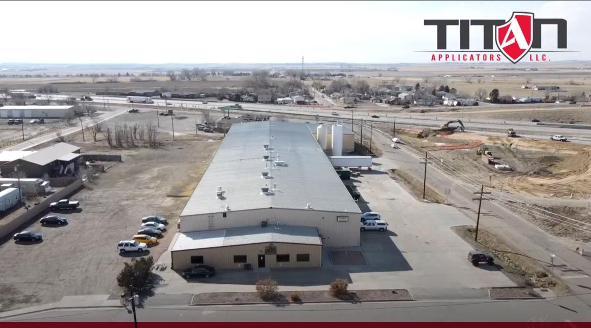 titan team installing new coating on restaurant rooftop
