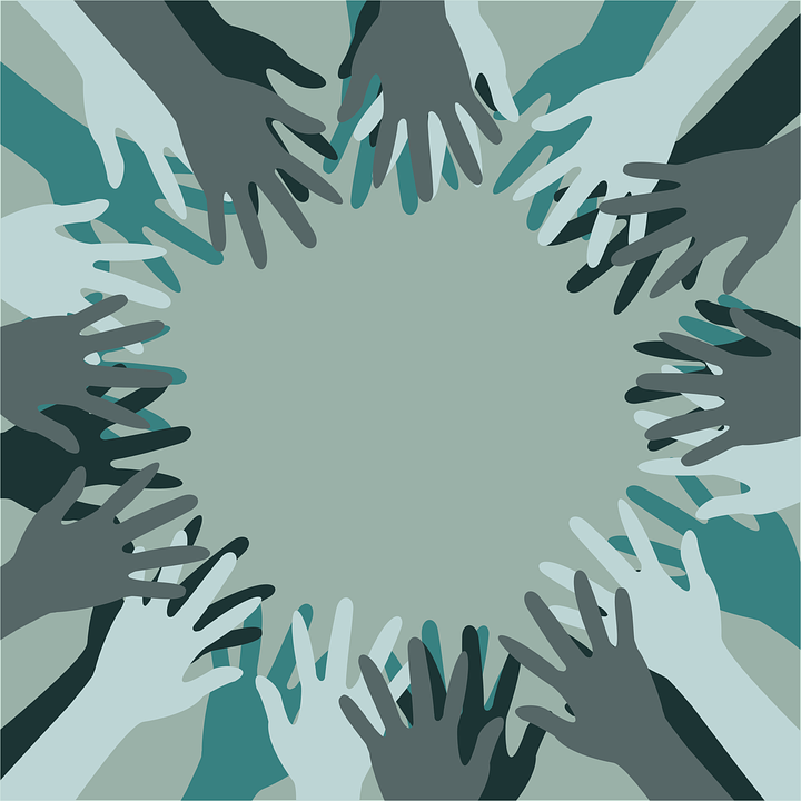 It takes <span class='ent _people'>people</span> of all shapes, sizes and colours to make a good team. The picture depicts many hands of different skin colours joining in a circle as a metaphor for <span class='ent _diversity'>diversity</span> and togetherness
