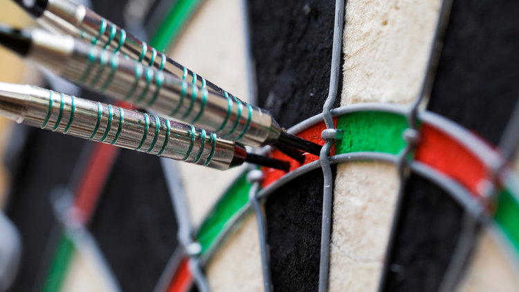 Group of darts in a dart boards.
