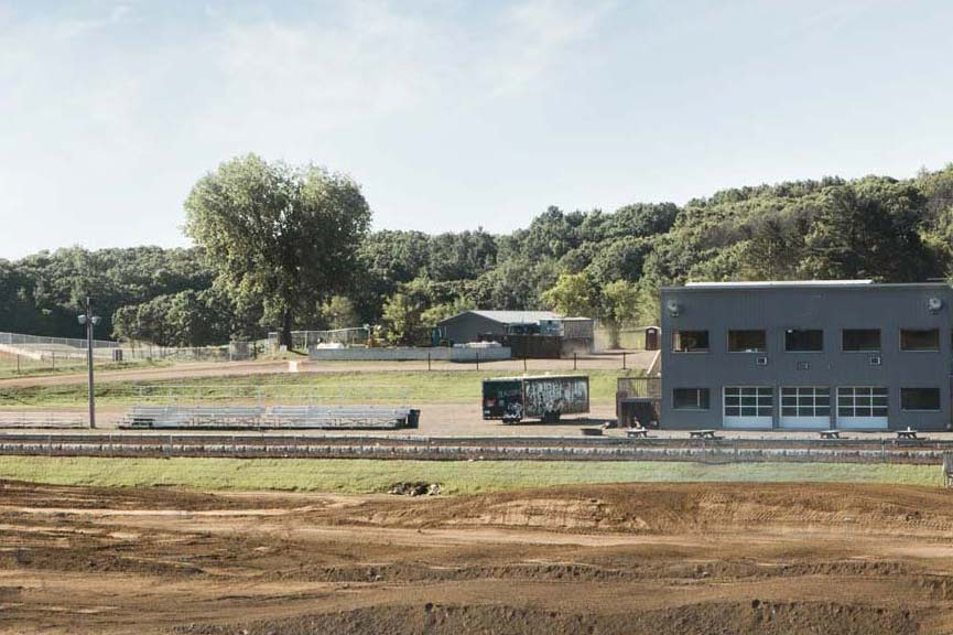 Spacious, undeveloped land with a clean, modern facility
