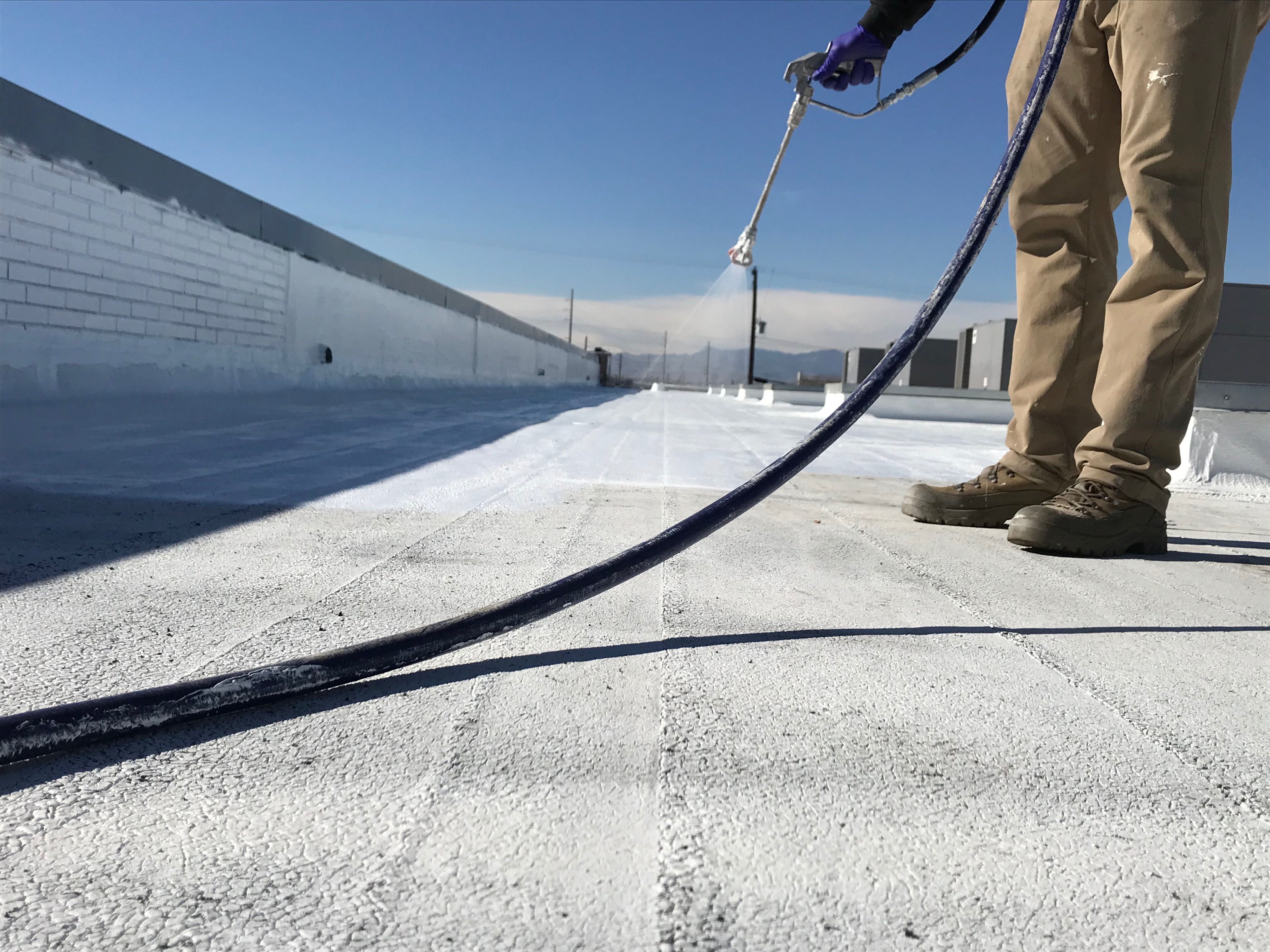 Silicone roof coating application.